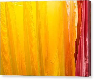 Yellow Orange And Red Bed Sheets Bright And Colorful Canvas Print by Matthias Hauser