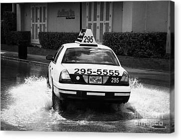 Yellow Taxi Cab Driving Through Streets Flooded By Heavy Rainfall Key West Florida Usa Canvas Print