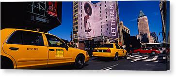Yellow Taxies At The Road Intersection Canvas Print by Panoramic Images
