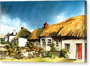 Yellow Thatch In Adare  Limerick Canvas Print by Val Byrne