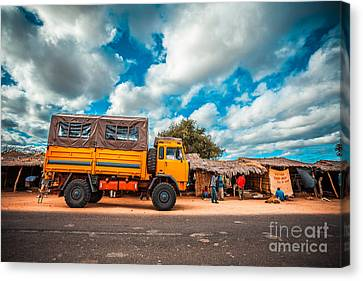 Yellow Truck In Africa Canvas Print by Sabino Parente
