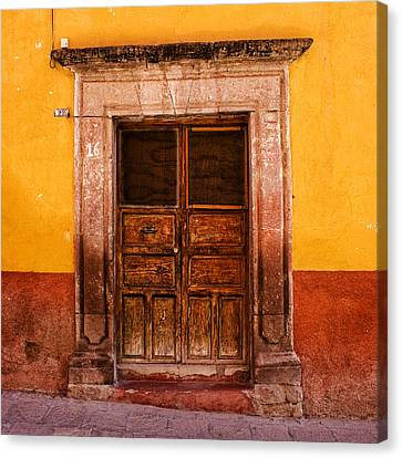 Yellow Wall Wooden Door Canvas Print by Carol Leigh