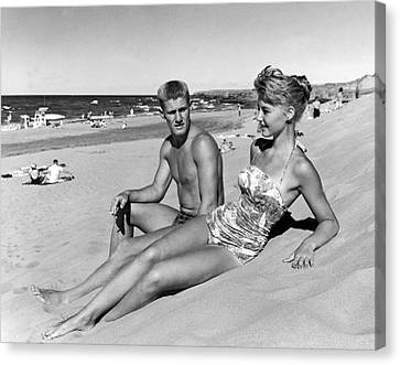 Young Adults On A Beach Canvas Print by Underwood Archives