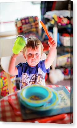Young Boy At The Dinner Table Canvas Print