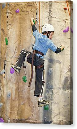 Young Boy On A Climbing Wall Canvas Print by Ashley Cooper