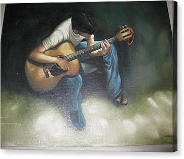 Young Boy Playing The Guitar Canvas Print