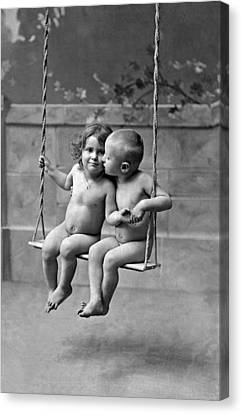Young French Lovers On A Swing Canvas Print by Underwood Archives