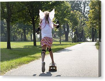 Young Girl Skateboarding While Wearing Canvas Print by Mary Ellen McQuay