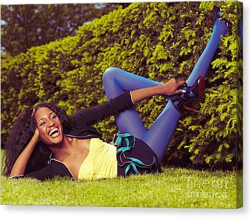 Young Happy Black Woman Lying On The Grass Canvas Print by Oleksiy Maksymenko
