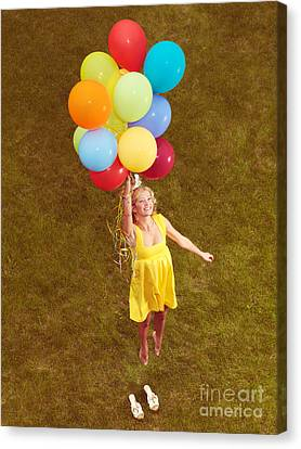 Young Happy Woman Flying On Colorful Helium Balloons Canvas Print by Oleksiy Maksymenko