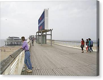 Young Lady On The Pier In Scheveningen Netherlands Canvas Print by Ronald Jansen