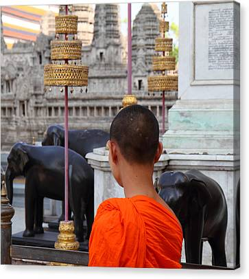Young Monk With Chang Statue - Grand Palace In Bangkok Thailand - 01131 Canvas Print by DC Photographer