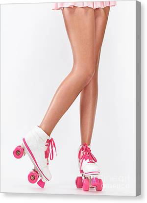 Young Woman Long Legs In Pink Roller Skates Canvas Print by Oleksiy Maksymenko