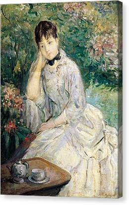 Young Woman Seated On A Sofa Canvas Print by Berthe Morisot