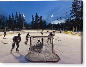 Youth Hockey Action At Woodland Park Canvas Print by Chuck Haney