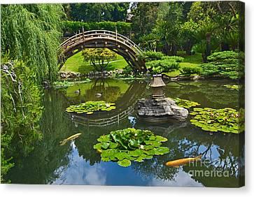 Zen - Japanese Garden With Moon Bridge And Lotus Pond With Koi Fish. Canvas Print