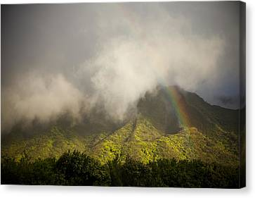 A Rainbow Shines Over The Rugged Canvas Print by Taylor S. Kennedy