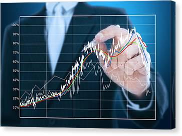 Businessman Writing Graph Of Stock Market  Canvas Print by Setsiri Silapasuwanchai