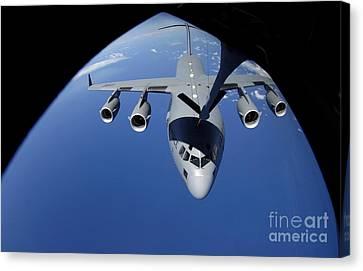 A C-17 Globemaster IIi Receives Fuel Canvas Print by Stocktrek Images