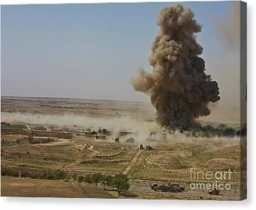 A Cloud Of Dust And Debris Rises Canvas Print by Stocktrek Images