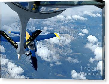 A Kc-135 Stratotanker Refuels An Fa-18 Canvas Print by Stocktrek Images