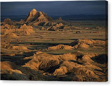A Landscape Of Isolated Buttes And Rock Canvas Print by Annie Griffiths