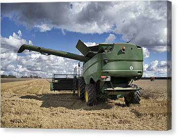 A Large Combine Harvester Machinery Canvas Print by Jaak Nilson