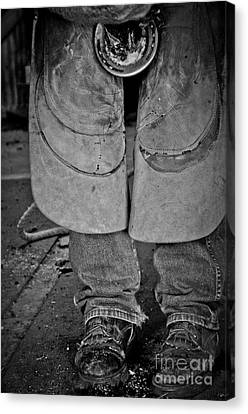 Canvas Print featuring the photograph A Man At Work by Tamera James