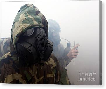 A Marine Wearing A Gas Mask Canvas Print by Stocktrek Images