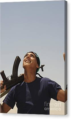 Ak-47 Canvas Print - A Rebel Fighter With An Ak-47 Assault by Andrew Chittock