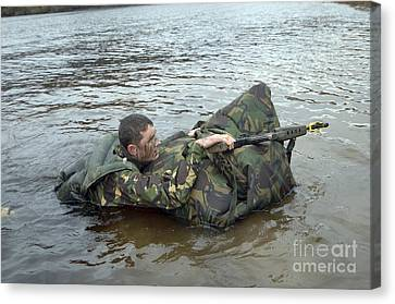 A Soldier Participates In A River Canvas Print by Andrew Chittock
