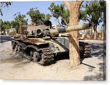 A T-72 Tank Destroyed By Nato Forces Canvas Print by Andrew Chittock
