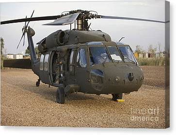 Baghdad Canvas Print - A Uh-60l Black Hawk With Twin M240g by Terry Moore