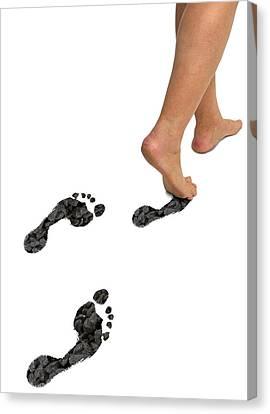 A Woman's Feet Leaving Carbon Footprints Canvas Print by Victor De Schwanberg