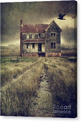 Abandoned Eerie Farmhouse With Dark Clouds Canvas Print by Sandra Cunningham