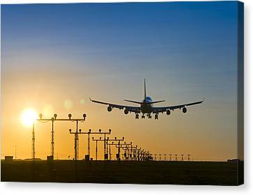 Aeroplane Landing At Sunset, Canada Canvas Print by David Nunuk