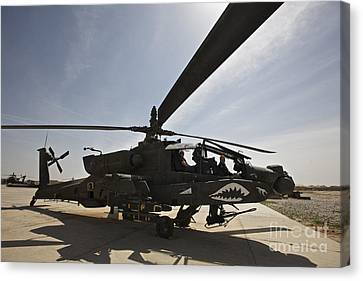 An Ah-64d Apache Helicopter Parked Canvas Print by Terry Moore