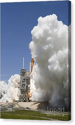 An Exhaust Plume Forms Around The Base Canvas Print by Stocktrek Images