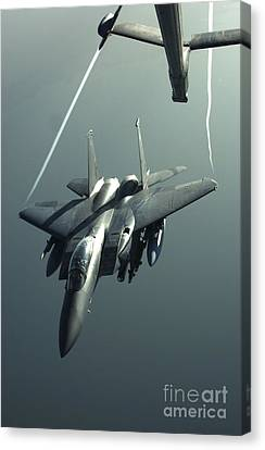 An F-15e Strike Eagle Flies Over Iraq Canvas Print by Stocktrek Images