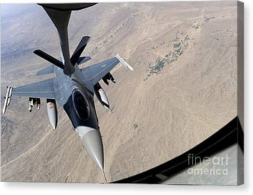 An F-16 Fighting Falcon Receives Fuel Canvas Print by Stocktrek Images