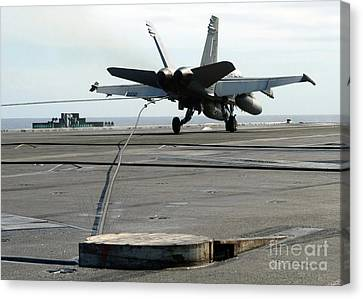 An Fa-18c Hornet Makes An Arrested Canvas Print by Stocktrek Images