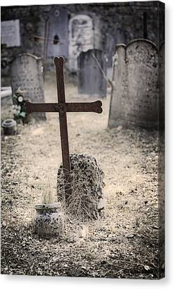 An Old Cemetery With Grave Stones Canvas Print by Joana Kruse