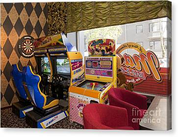 Arcade Game Machines At A Diner Canvas Print by Jaak Nilson
