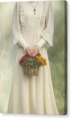 Basket With Flowers Canvas Print by Joana Kruse