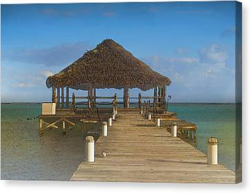 Beach Deck With Palapa Floating In The Water Canvas Print by Brandon Bourdages