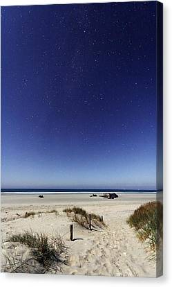 Beach Under A Full Moon Canvas Print by Laurent Laveder