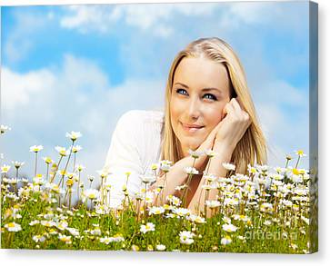 Beautiful Woman Enjoying Daisy Field And Blue Sky Canvas Print by Anna Om