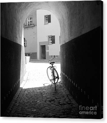 Bicycle In Tunnel Canvas Print by Gordon Wood