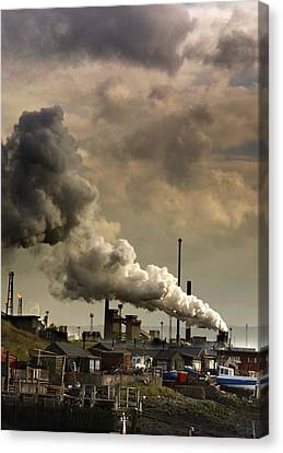 Black Smoke Emitting From Factory Canvas Print by John Short