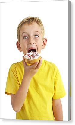 Boy Eating A Doughnut Canvas Print by Ian Boddy